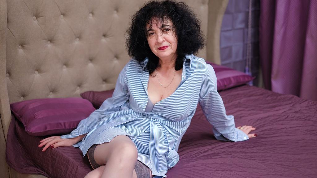 Stunning mature brunette Sammy undressing and fingering her cunt  198013
